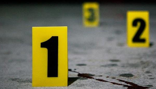 Investigación en escenario de crimen